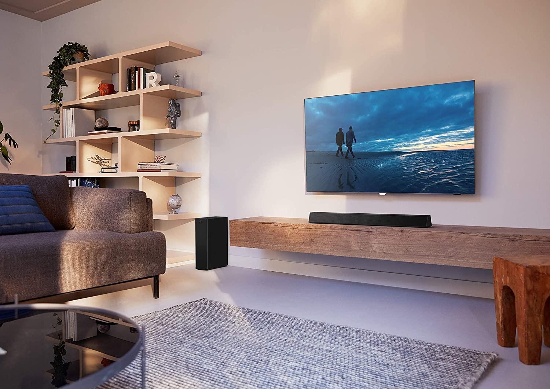Philips Bluetooth TV Soundbar HTL3310/10 en situation dans le salon.